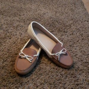 Michael Kors tan and white loafers